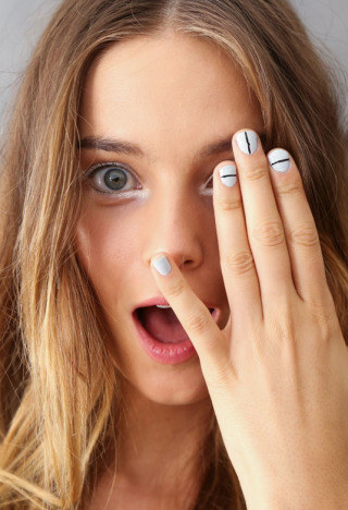 This simple modern look is just white polish with a black line.