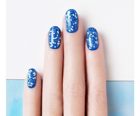 This topcoat makes it look like you applied meticulous polka dots.