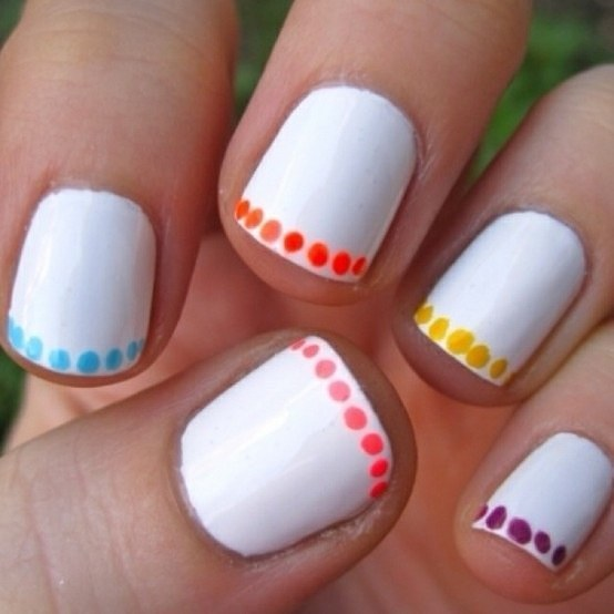 For a cool touch, just do a line of polkadots around the edge of your nail.