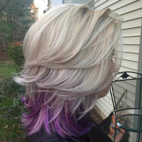 4-medium-blonde-layered-hairstyle-with-lavender-peekaboo-highlights
