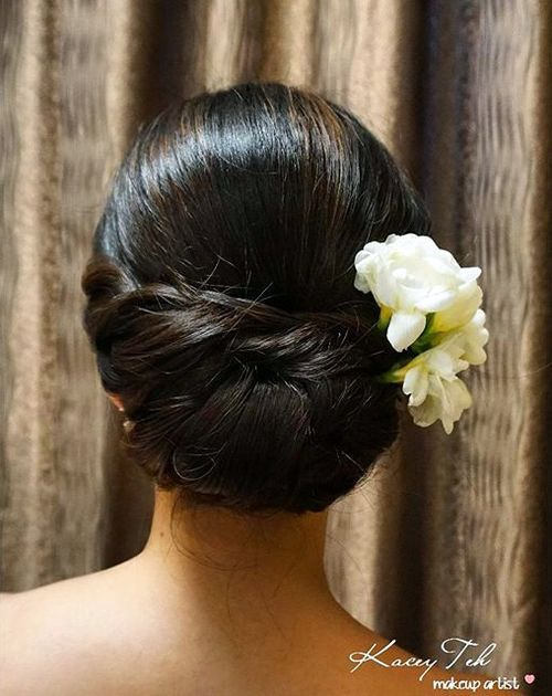 9-polished-chignon-with-hair-flowers