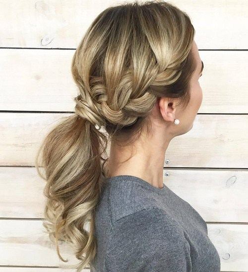 8 messy low ponytail with a side braid