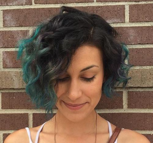 2 asymmetrical wavy brunette bob with teal ends