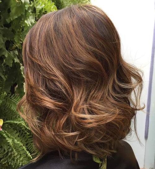 33 long curled brown bob with subtle highlights
