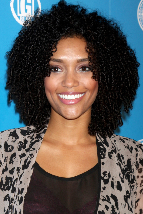 8 medium length natural black curly hairstyle