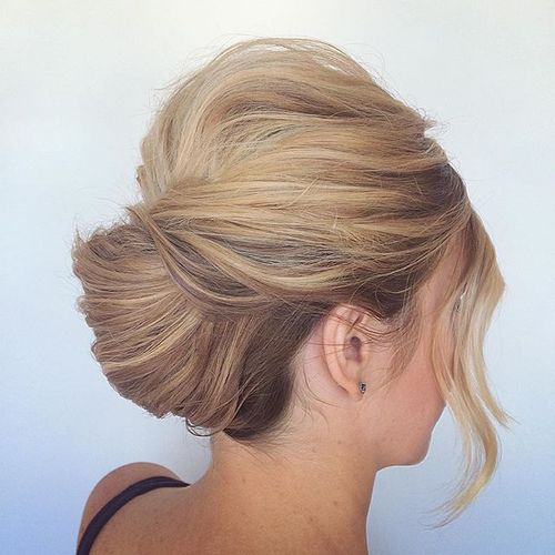 11 low french twist updo with a bouffant and bangs