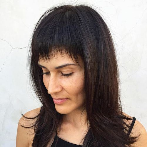 35 medium layered dark brown hairstyle