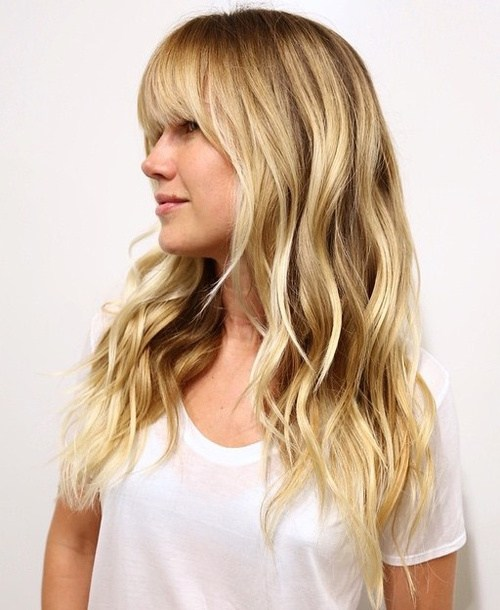 4 layered wavy blonde hairstyle with bangs