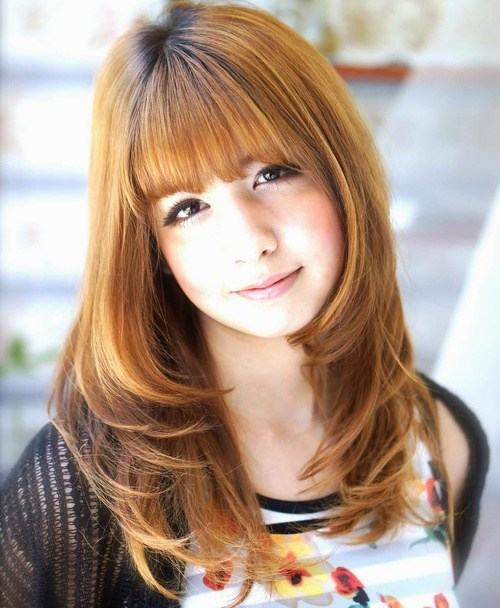 7 hairstyle with straight bangs and framing layers