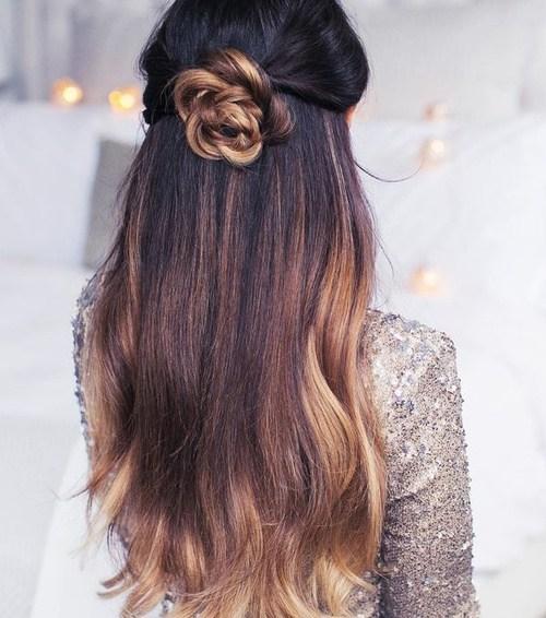 1 half up flower bun hairstyle