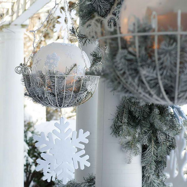 21 Elegant Hanging Baskets with Frosted Evergreen Branches and Sparkling Accents