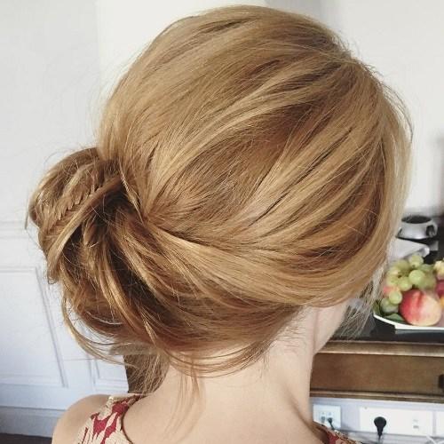 7 side bun with a braid