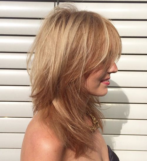 1 layered tousled blonde hairstyle for straight hair