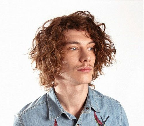4 medium disheveled curly mens hairstyle