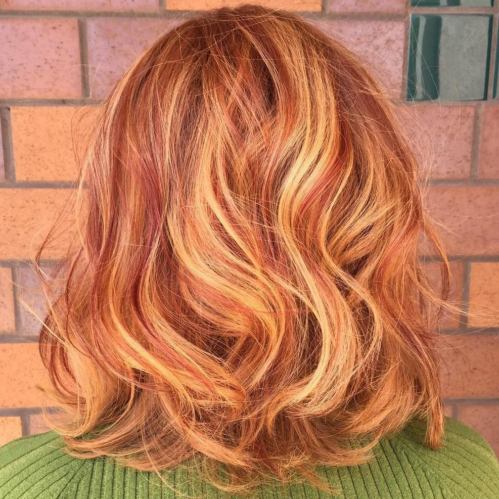 1 auburn lob with strawberry blonde highlights