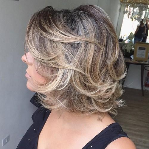 1 medium curly layered hairstyle
