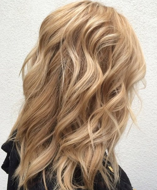 1 medium layered sandy blonde hairstyle