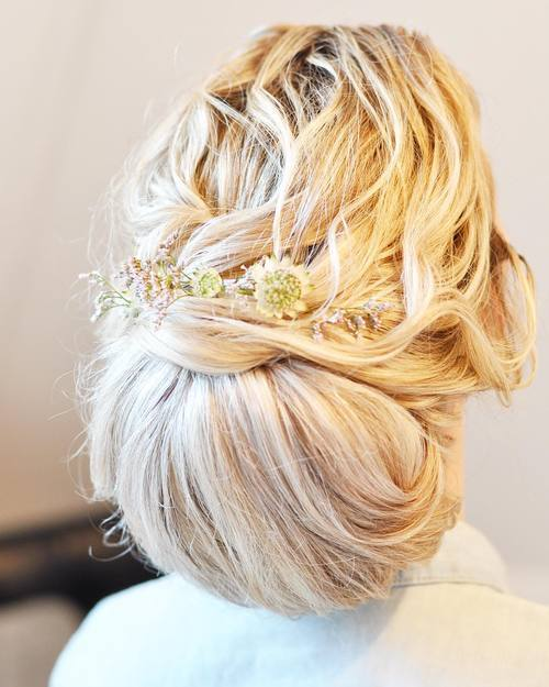 1 messy chignon updo for long thick hair