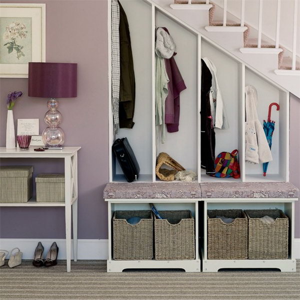 12 Take Advantage of Space under Stairs to Create a Mudroom for Each Family Member to Hang their Coats Umbrella and Boots in