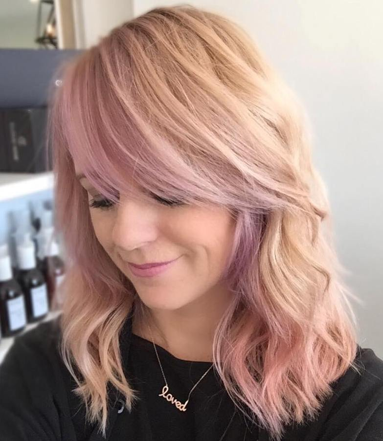 12 pastel ping wavy hairstyle with side bangs