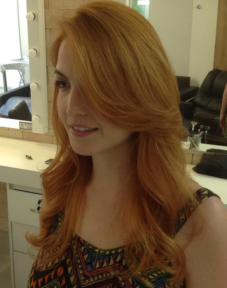 21 long side parted strawberry blonde hairstyle