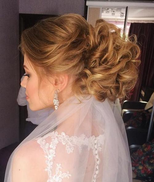 31 curly voluminous updo for brides
