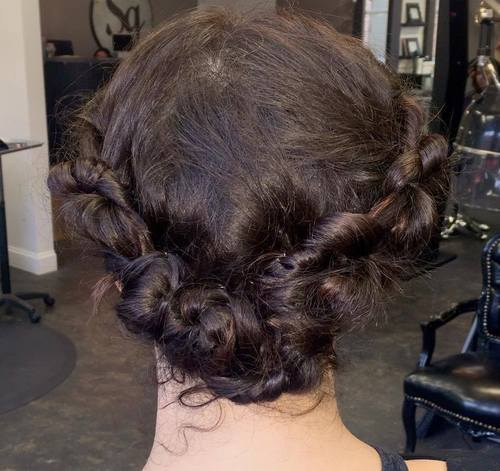 20 messy knotted roll updo