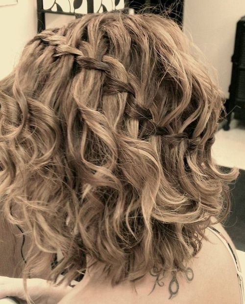 22 medium curly hairstyle with a diagonal waterfall braid