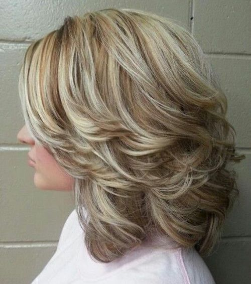 24 medium curly hairstyles with highlights and back swept layers
