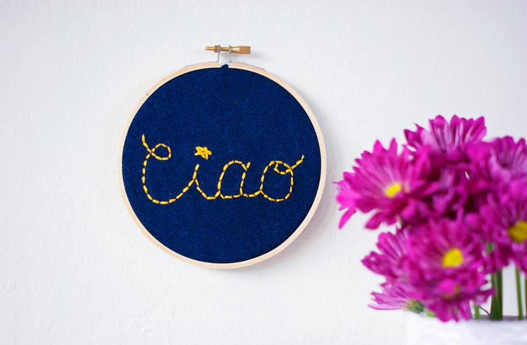 31 Turn old jeans into this charming embroidered wall sign