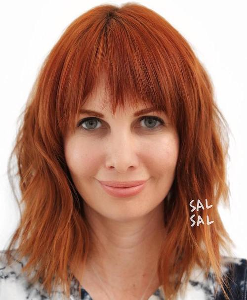 1 shaggy red hairstyle with bangs