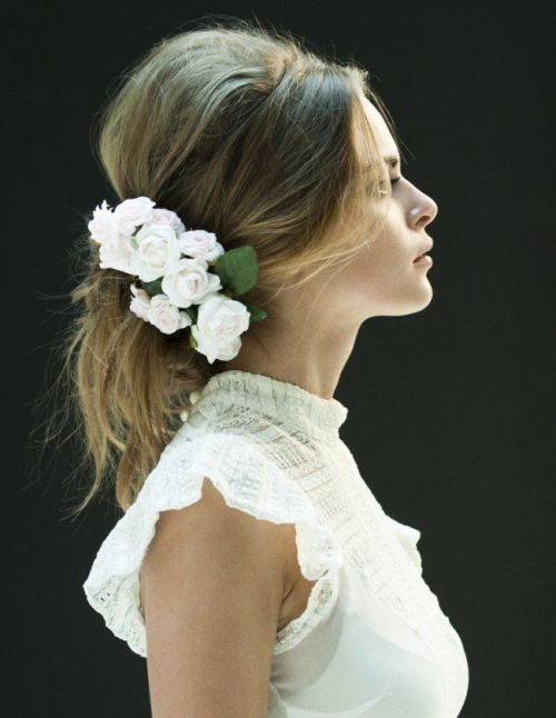 15 messy pony with a bouffant and hair flowers