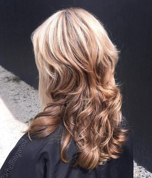 3 long shag curly hairstyle