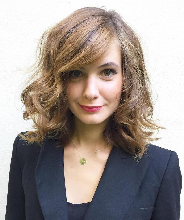 12 midlength sideparted layered hairstyle