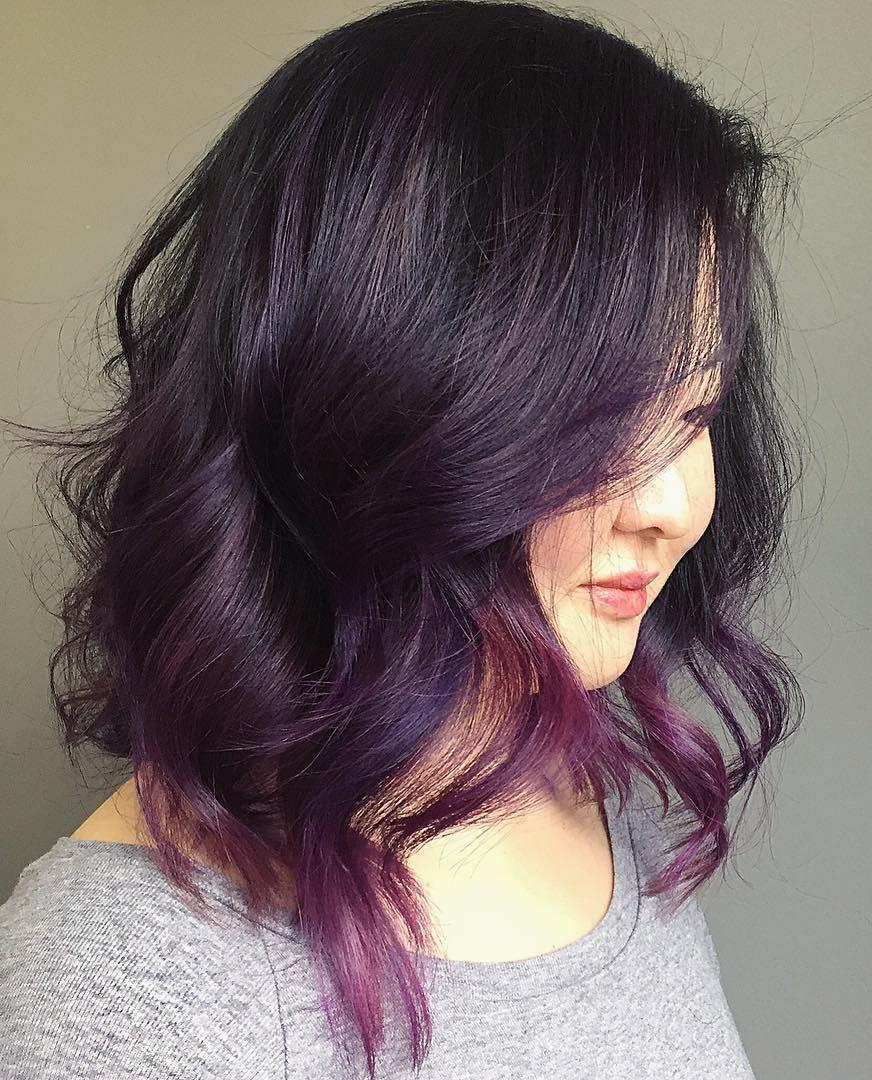 16 black wavy bob with purple balayage
