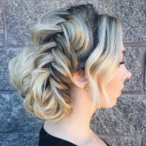 20 loose fishtailed updo with bangs