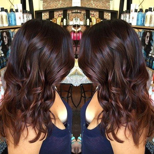 25 medium wavy chocolate brown hairstyle