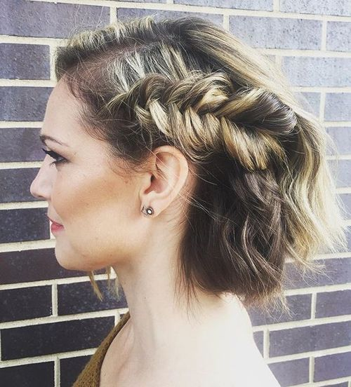 34 loose updo with a side fishtail