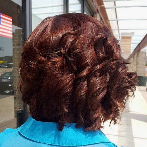 34 shorter reddish brown curly hairstyle
