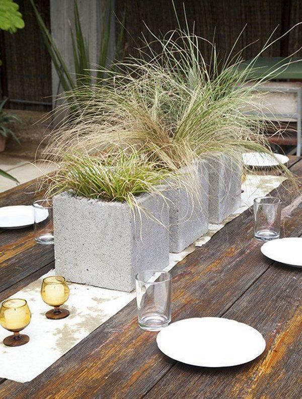 12 Modern Grassy Centerpieces in Cinder Blocks