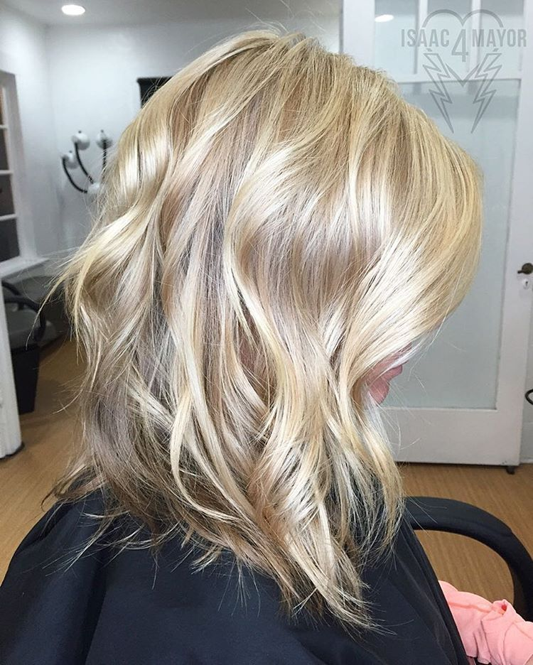 13 midlength shiny blonde hairstyle