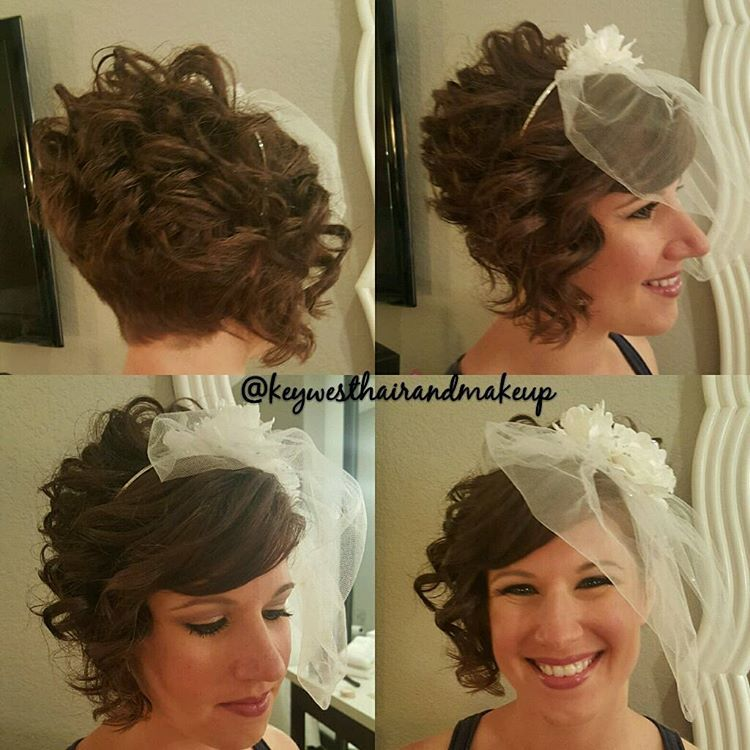 14 short curly bridal hairstyle with veil
