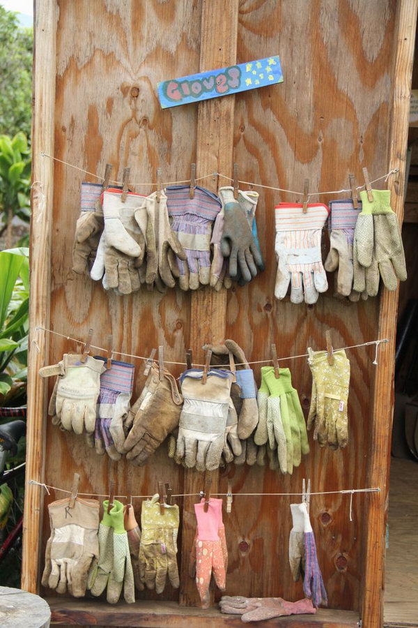 15 Use Some Clothes Hooks and Some Rope to Dry Your Gloves
