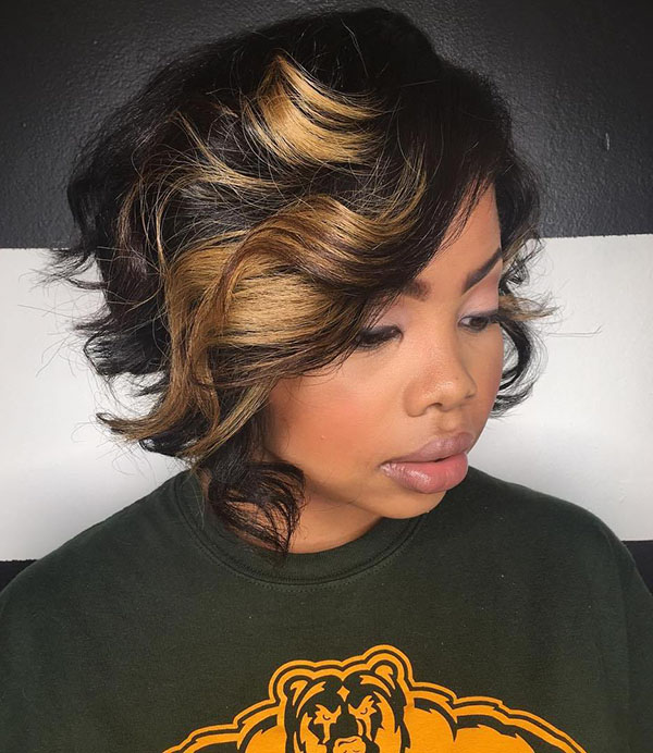 27 black curly bob with chunky highlights