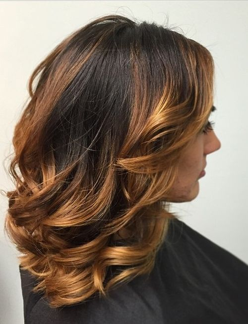 27 medium brunette layered hairstyle with golden brown balayage