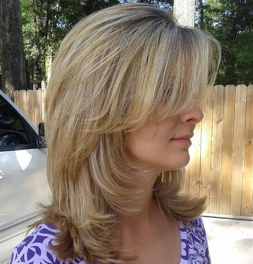 3 medium layered haircut with side bangs