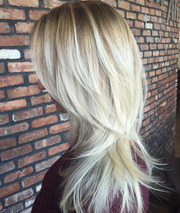 34 blonde layered hair with root fade