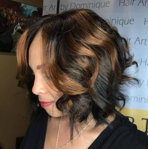 37 black wavy bob with caramel highlights