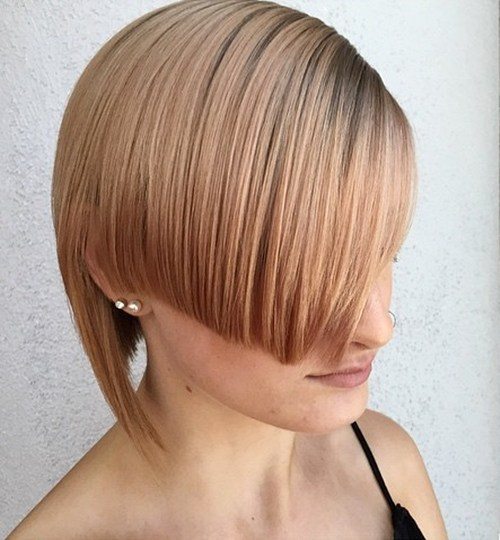 38 short angled asymmetrical strawberry blonde hairstyle