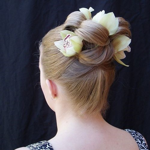 38 sleek updo with flowers
